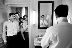 great way to incorporate the groom getting ready with his groomsmen in one pic