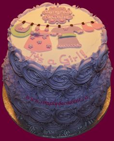 2 Tier Baby Shower Cake with Lilac Buttercream Rosettes and Baby Clothesline