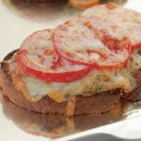 Tuna Melt    In this updated version of the tuna melt, we go light on the mayo and top it with fresh tomato slices and shredded sharp Cheddar, which allows us to use considerably less cheese while ensuring that there's great cheese flavor in each gooey bite.