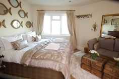 Peach and perl style bedroom with fish shaped mirrors and luxury quilt. Angmering-On-Sea, West Sussex UK