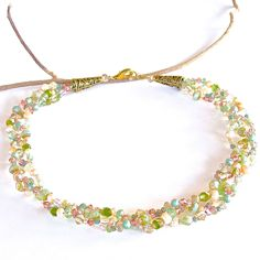 Eostre: Pastel Braided Necklace $75.00  A stunning  freshwater pearl and crystal statement piece in the delightful hues of spring. This is a classic look with an elegant modern twist. Full length is 18″. https://earthandmoondesign.com/shop/beadz-by-roz/eostre-pastel-braided-necklace/