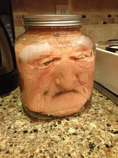Easy Halloween decoration, put a mask in a jar of water