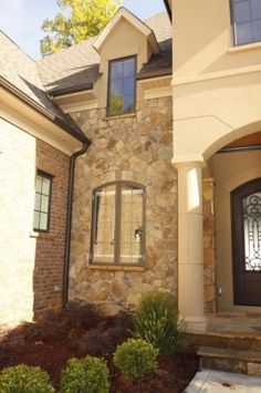 I love the combination of brick, stone, and stucco on a home's exterior.