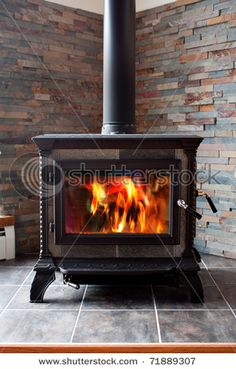 slate tile behind the wood stove. This is what we are doing behind our wood stove and behind our oven:) love it.