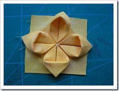 "My friend, Marianna, made this FREE tutorial on ""folded"" flowers!"