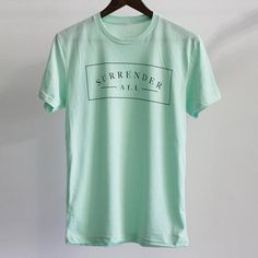 """This is a super-soft unisex tee with our """"Surrender All"""" design. FIT: Unisex - Runs true to size. *Mint with vintage charcoal design. Size Bust/Chest Inches XS 30-32 Small 34-36 Medium 38-40 Large 42-"""
