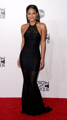 Who: Christina Milian Wore: A slinky black halter dress Where: 2014 American Music Awards via @stylelist   http://aol.it/1FjTLdX