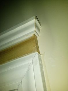 Diy how to add crown molding to door and window headers for Standard crown molding size