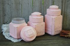 Set of 3 pressed glass shabby chic canisters with air tight seals. Hand painted…