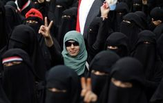 In this Thursday, Sept. 8, 2011 file photo, a female protestor, center, flashes the victory sign during a demonstration in Sanaa, Yemen demanding the resignation of President Ali Abdullah Saleh. Women are fighting to keep a voice for their rights sounding out amid the tumult of Yemen's landmark revolt. The main goal of the protests by millions around the country, day in and day out since February, is the ouster of President Saleh.