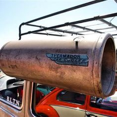 air conditioner, you hang out car window and fill with water, it then blows cooled air into car. was used often on VW bugs.