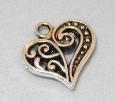 Tibetan filigree heart - antique silver-tone