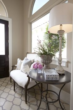 entrances/foyers - ivory gray Moorish tiles floor French settee white gray chevron pillow round iron accent table bone inlay box Stunning modern