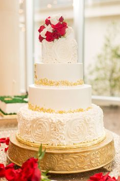 Alexis and Kyle's wedding cake had amazing details. The white frosting had intricate floral designs, and there were gold accents upon each tier! This gorgeous cake was topped with flowers that matched their wedding theme and color scheme! Ashton Gardens, White Frosting, Unique Wedding Venues, Gorgeous Cakes, Chapel Wedding, Floral Designs, Gold Accents, Color Schemes, Wedding Cakes