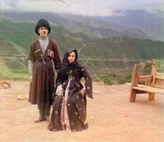 ca. 1907-1915  A couple in traditional dress poses for a portrait in the mountainous interior region of Gunib on the north slope of the Caucasus Mountains in what is today the Dagestan Republic of the Russian Federation.