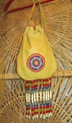 Vintage Native American Purse-Leather Beaded Fringe-Hippie Boho-1970s. $40.00, via Etsy.