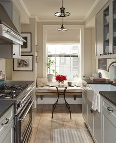 love everything about this kitchen! the floors, the nook, the chicken wire cabinets...