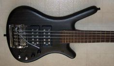 2007 Warwick 5 String Bass in Nirvana Black with a Kahler tremolo with extra wide string spacing.  Some bass players prefer the tremolo arm on the top.