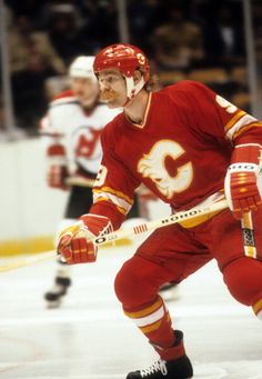 Lanny McDonald of the Calgary Flames skates on the ice during an NHL game against the New Jersey Devils circa 1984 at the Brendan Byrne Arena in East Rutherford, New Jersey. Maurice Richard, Lanny Mcdonald, Flame Picture, Mario, East Rutherford, Ice Hockey Teams, Nhl Games, Good Old Times, New Jersey Devils