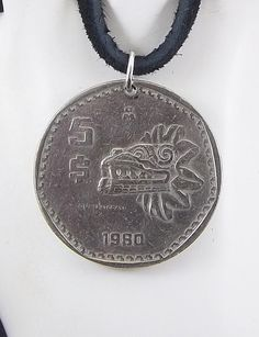 Mexican coin necklace - https://www.etsy.com/listing/249884922/quetzalcoatl-coin-necklace-mexican-5