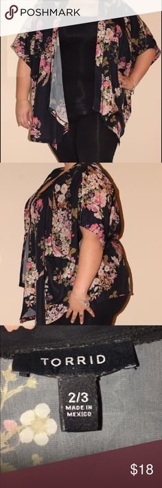 Floral Torrid Kimono This black floral print kimono is so breezy and so soft and silky. Worn less than five times. Put it over a little black dress, or a cami and jeans/leggings. Can be dressed up with jewelry. #size2/3 #Torrid #plussize #plussized #plus #curvygirls #silky #kimono #floralprint torrid Jackets & Coats Capes