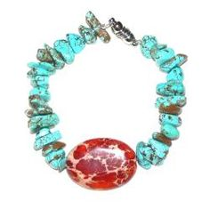 """""""Monsoons"""" designed by Susen Foster - A simple duet of stones, each with their own strong personality, is plenty for this showpiece. Turquoise nuggets and a large oval of red orange Impression Jasper are a perfect match. No magnet. Better clasps."""