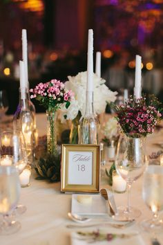 Elegant table number with wine bottle candle holders. #miami #stregis #balharbour #luxury #wedding #bride #groom