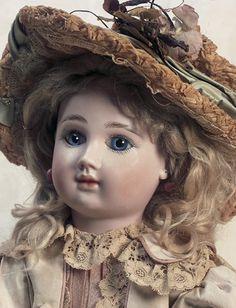 "French Bisque Bebe,Figure D,by Jules Steiner  18"" (46 cm). Marks: Steiner Paris Fre D 12 (head) Le Petit Parisien 1889 (paper label with doll holding flag). Comments: Jules Steiner,circa 1889."