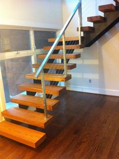 Heartpine treads finished with monocoat and redoak floors stained, finished, and cured with Radcoat UV finish.