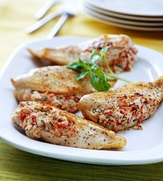 The feta and fat-free cream cheese stuffing make this main dish chicken recipe rich in taste yet low in calories.