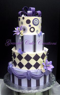 pictures of custom designed wedding cakes in buttercream and fondant.
