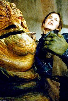 Carrie Fisher - Leia Organa captured by Jabba the Hutt - Star Wars : The Empire Strikes Back Star Wars Film, Star Wars Episoden, Leia Star Wars, Princesa Leia, Jabba The Hutt, Pin Up, Episode Iv, The Empire Strikes Back, Carrie Fisher