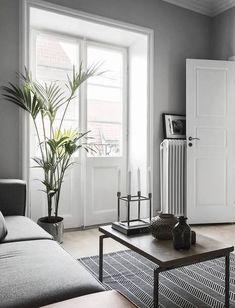 Monochrome home with a glass partition - via Coco Lapine Design
