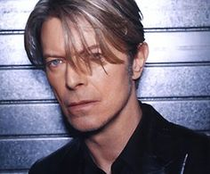 David Bowie....my big sis introduced me to him when I was pretty young..didn't get a chance to see him live until he was touring with one of my all time fave bands NIN.....what a great experience to see such talents work together......unforgettable