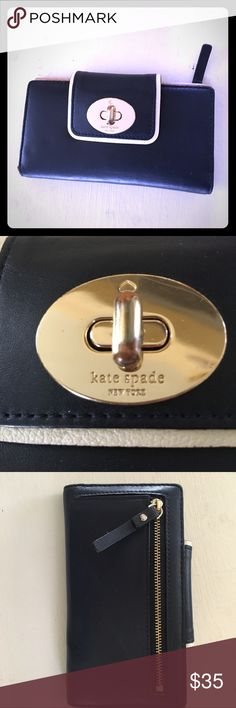 Navy Kate Spade Wallet This adorable twist turn Wallet is perfect for summer in this pretty shade of Navy. Some wear as shown in the pictures on the clasp to open. Other than that it's really great condition. kate spade Bags Wallets