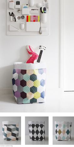 Aren't these fabric bins by Varpunen awesome (via Coos & Ahhs). They seem perfectly suited for any sort of room...from nursery (use them to hold toys and books) to living room (use one to store magazines, and another to hold throw blankets). Better still, if they start getting a little grimy you can just toss them in the wash and before you know it they'll be good as new again! That's the sort of organization I can really get behind. xo Ez