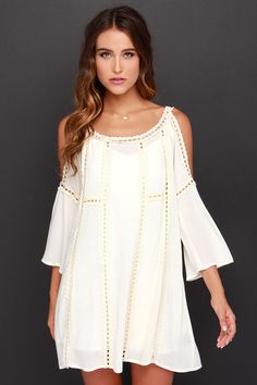 You'll take any chance to wear the dreamy design of the Do-Over Cream Crochet over and over again! Crocheted lace trims and supports the delicately textured woven bodice, with a breezy shift shape and panels of more crocheted lace throughout. Cold shoulder cutouts lead into belled three-quarter sleeves for a Bohemian finish. Detachable slip lining has adjustable spaghetti straps. Self: 100% Rayon. Lining: 100% Polyester. Dry Clean Only.