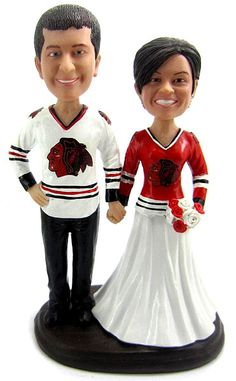 Customized Hockey Wedding Cake Toppers...Hey @Laurien Corey I found your cake topper, lol