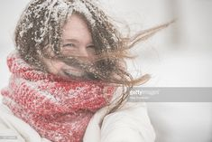 Stock Photo : Teenager girl under snowfall at the street