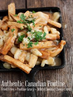 Authentic Canadian Poutine Recipe: fries smothered in poutine gravy and white cheddar cheese curds.  Not sure how readily available cheese curd is in the UK, might have to substitute with mozzarella.  About a million calories, but absolutely delicious!