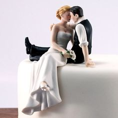 What a nice couple for a wedding cake at the top of a cupcake tower.