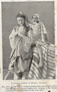An Algerian Jewish woman with ḥarqus designs on her forehead and ...