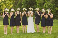 The bride and her bridesmaids hiding their faces, because they obviously want our eyes on those short mix-and-match black dresses & hydrangea #bouquets! {@wfphotos}