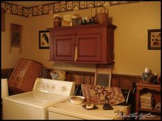 Primitive Country laundry room...I like the wash board hanging on the wall and the old iron on the dryer.