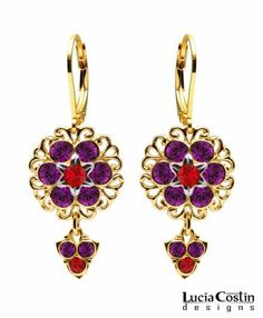 Fashionable Flower Earrings by Lucia Costin with Red and Violet Swarovski Crystal Flowers, Set with Lovely Charms and Filigree Details; 24K Yellow Gold over .925 Sterling Silver; Handmade in USA Lucia Costin. $57.00. Dangle earrings beautifully designed by Lucia Costin. Mesmerizing enough to wear on special occasions, but durable enough to be worn daily. Unique jewelry handmade in USA. Enriched with light siam and purple Swarovski crystals. Dangle ornaments accen...