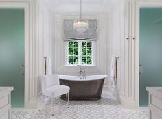 Stunning bathroom features a nook filled with a tiered crystal chandelier hanging over a cast iron tub and vintage style tub filler placed under a window dressed in a gray medallion roman shade. Description from decorpad.com. I searched for this on bing.com/images