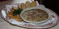 Maggiano's Famous Recipe - Spinach and artichoke al forno. The best spinach and artichoke dip I have ever had!! Will be making this for out NYE celebration, for sure!