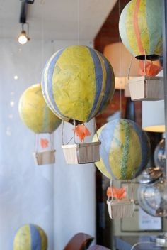 It would be cool to use maps as the final layer on the balloons! And colored tissue paper for stripes     spring window display by patrica