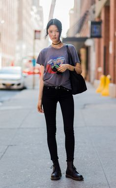 Somin Park from Street Style at New York Fashion Week Spring 2017 The model… Dr. Martens, ark skinny jeans and graphic tee