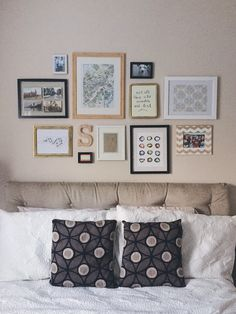 gallery wall above the bed